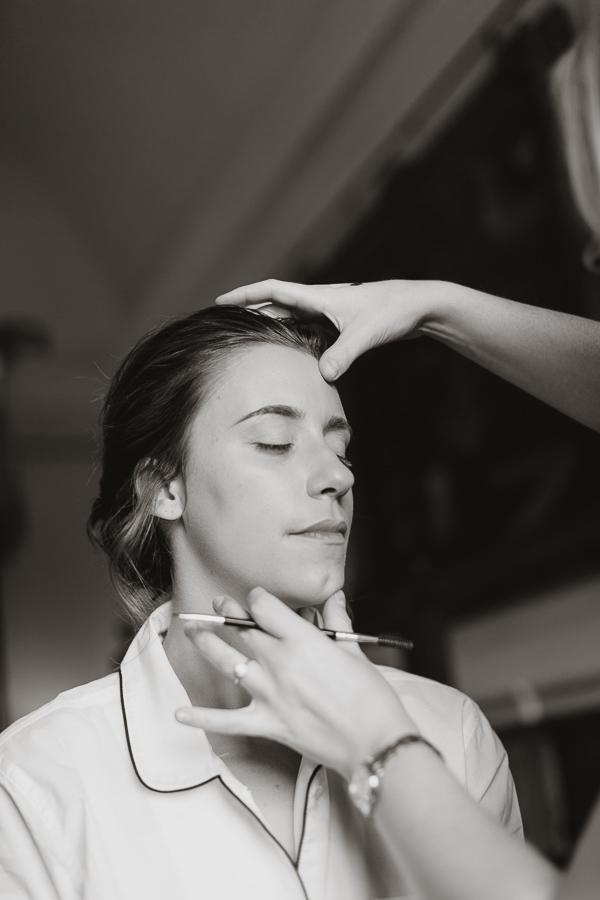 bridesmate getting her makeup done