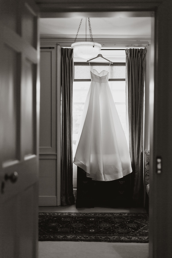 view of the room with dress hanging