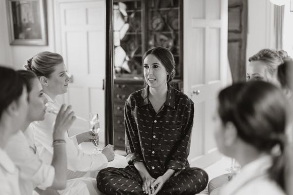 bride talking to her bridesmates
