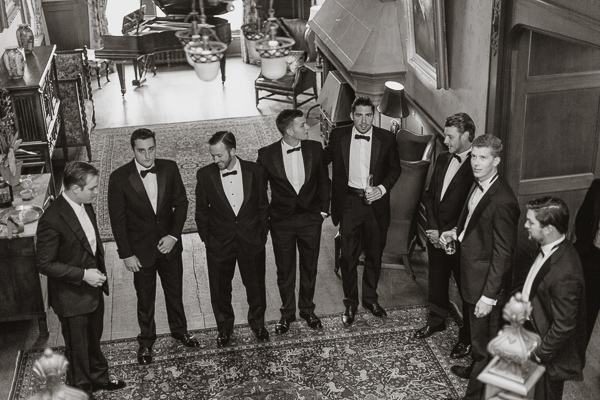 all groomsmen with groom in toxidos