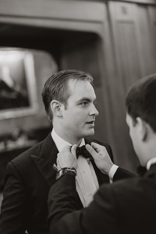 groom getting his bowtie fixed
