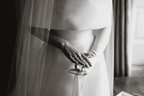 bride putting her gloves on