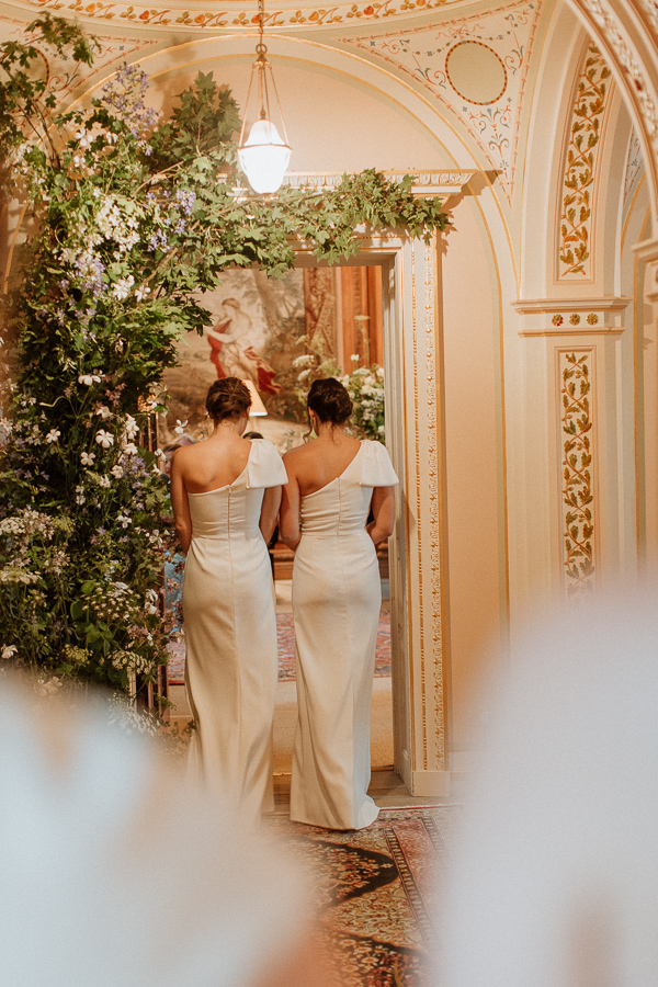 bridesmates walking down into tapestry room