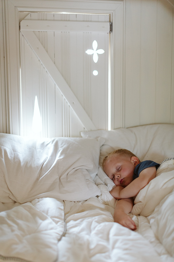 child sleeping in the summer house on the wedding day scotland