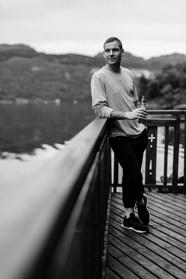 groom in the morning realxing by the shore on loch goil wedding day scotland