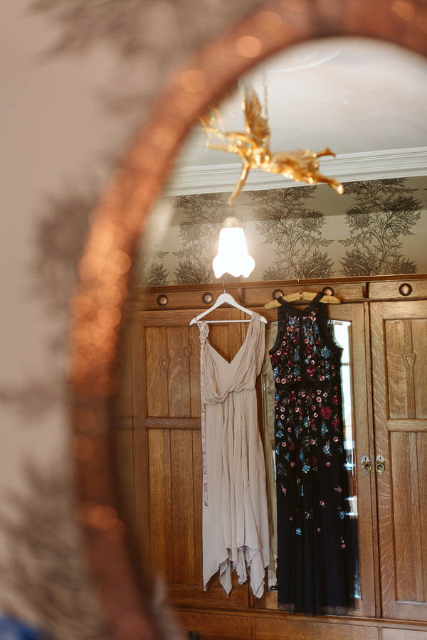 dresses hang in the bathroom at the lodge